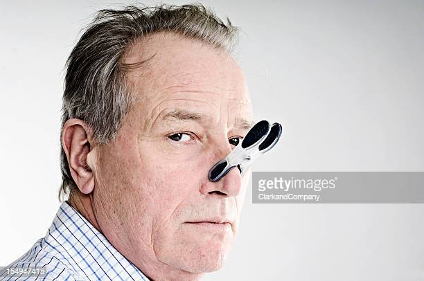 Business With Peg On His Nose.