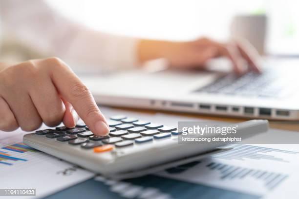 business woman accounting concept financial in office - rechnungswesen stock-fotos und bilder