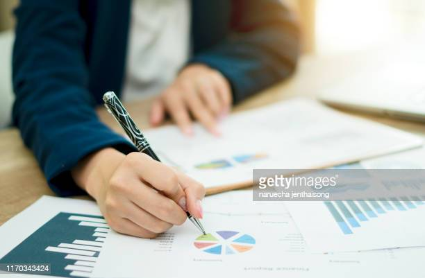 business woman analyzing investment charts with laptop. financial accounting concept. - financial figures stock pictures, royalty-free photos & images
