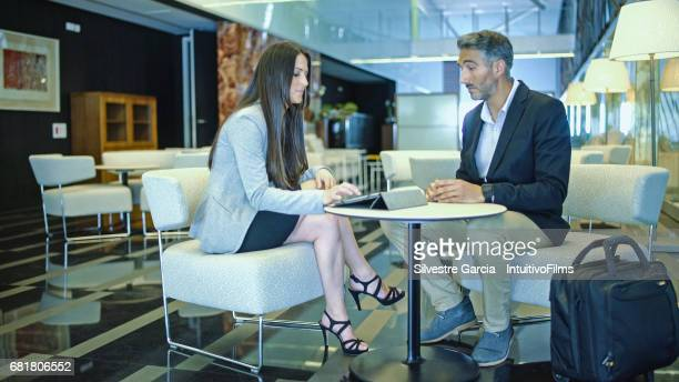 Business woman and bussines man in a meeting