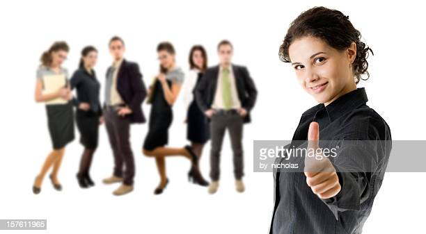 Business woman, and her team, with thumb up