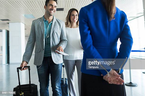 Business woman and man boarding plane.
