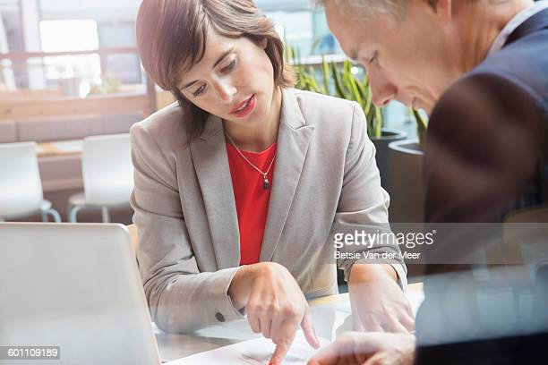 Business woman and man having a meeting.