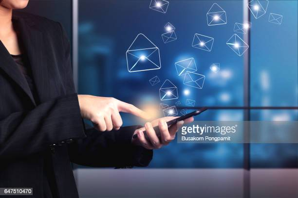 business woman are sending email marketing by digital smart phone - marketing icons stock photos and pictures
