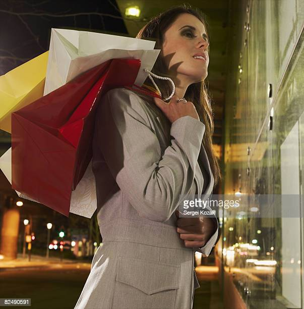 Business woman at night window shopping
