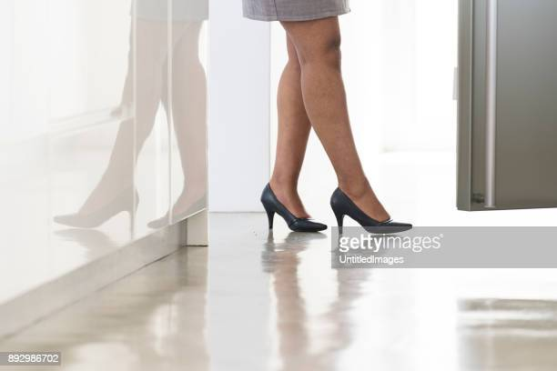 business woman at work - high heels short skirts stock pictures, royalty-free photos & images