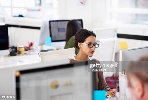 business woman at work station in start-up office - extra long stock pictures, royalty-free photos & images