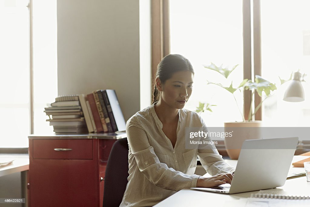 Business woman at working on laptop : Stock Photo