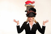 Business woman balancing life having to wear too many hats