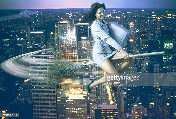 business woman being a modern witch flying through the air - witch flying on broom stock photos and pictures