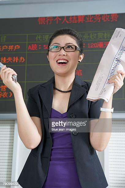 A business woman being excited in stock market.