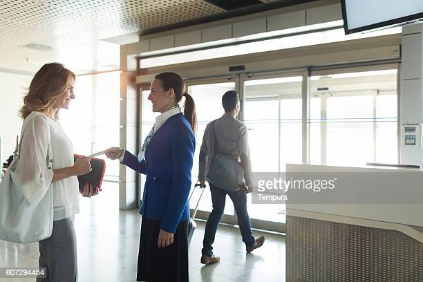 Business woman boarding a plane on departure gate.