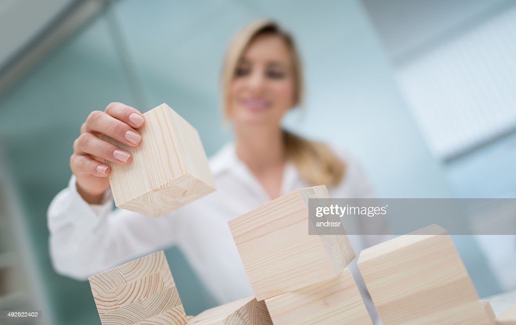 Business woman building a project : Stock Photo