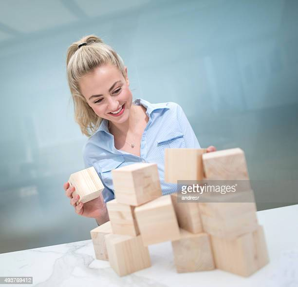 Business woman building a project