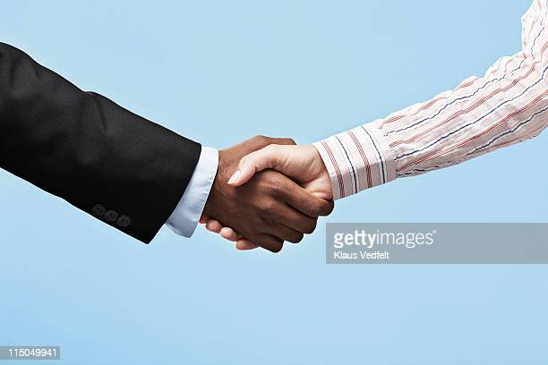 business woman & business man making handshake - long sleeved stock pictures, royalty-free photos & images