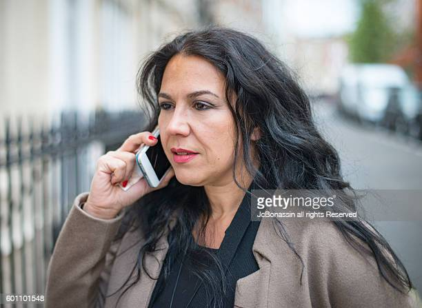 business woman by the phone - jcbonassin stock-fotos und bilder