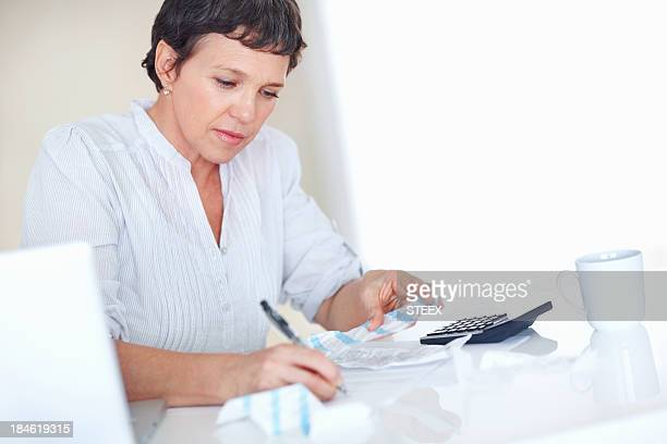Business woman calculating taxes