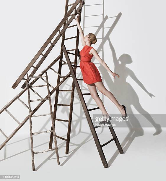Business woman climbing up ladders construction