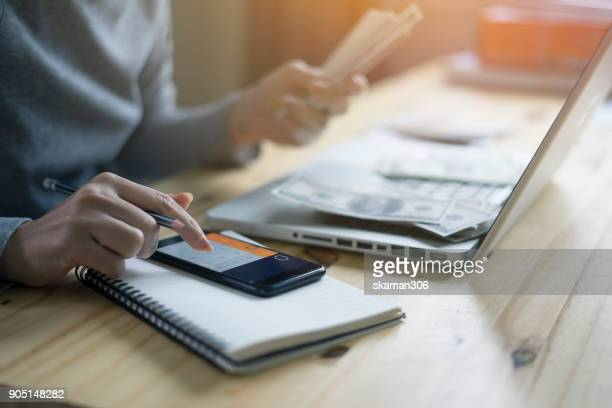 Business woman contacting  business team with smartphone and start up writing marketing plan