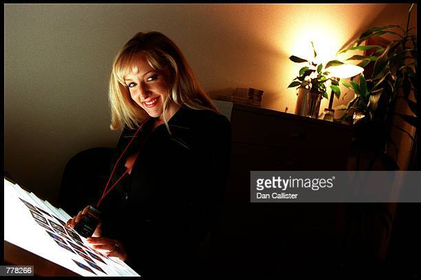 Business woman Danni Ashe looks at slides in her office August 30 2000 in Culver City CA Ashe owns Danni Hard Drive and is the host of the most...