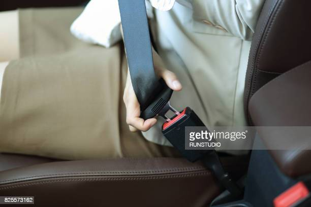 Business woman doing a safety belt