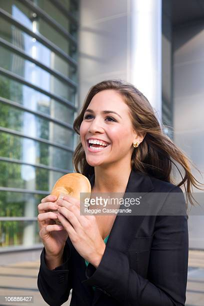Business woman eating on the go