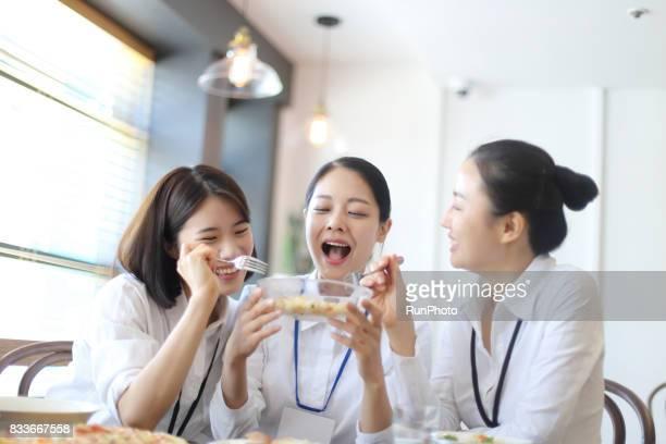 Business woman enjoying while eating