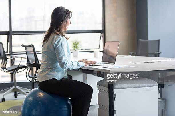 Business woman exercising at the office