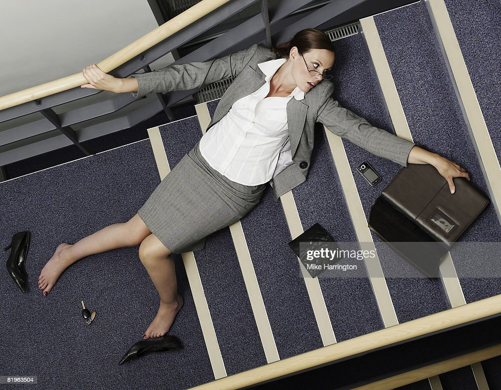 Business Woman Falling Down The Stairs Stock Photo