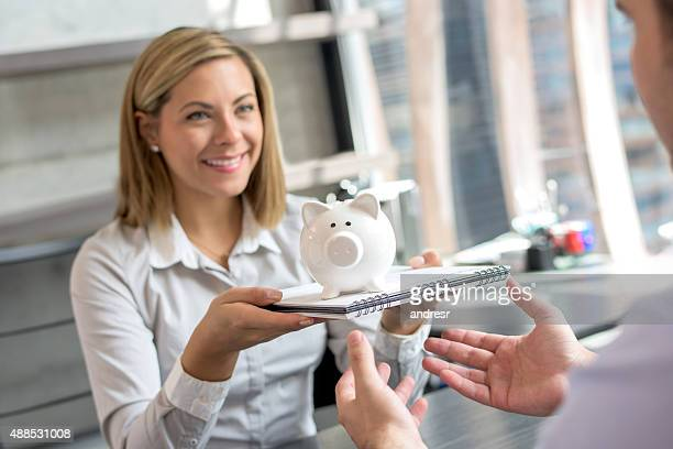 Business woman giving gifts to a client