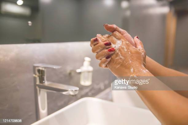 business woman hand washing with soap to prevent coronavirus - washing hands stock pictures, royalty-free photos & images