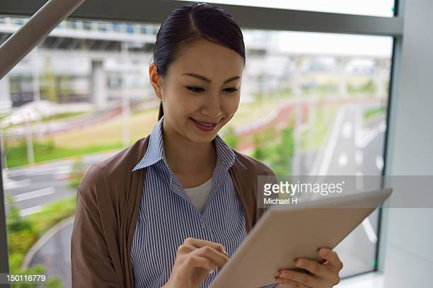 Business woman having a fun with a tablet PC