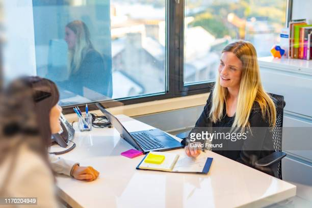 business woman having a job interview - david freund stock pictures, royalty-free photos & images