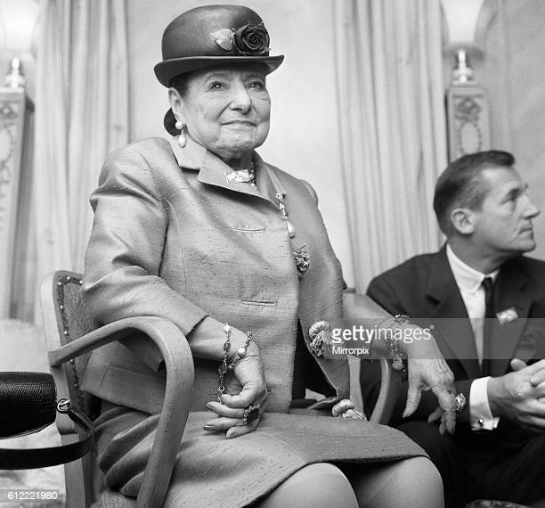 Business woman Helena Rubinstein seen here at the Dorchester Hotel London with couturier and dressmaker to the Queen Hardy Amies Rubinstein was at a...