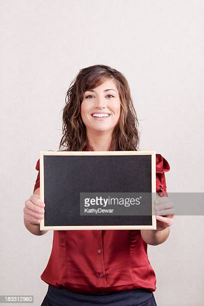 Business Woman Holding a Blank Chalk Board