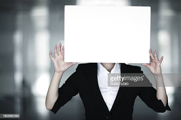 Business woman holding a sheet of paper