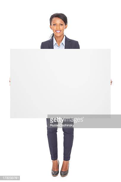 Business woman holding blank billboard