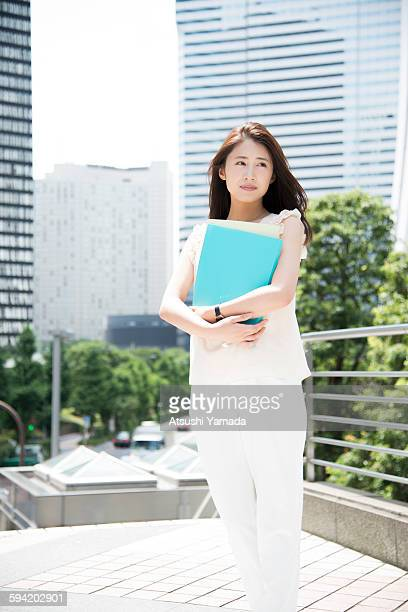 Business woman holding files