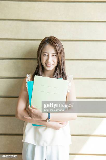 Business woman holding files,smiling