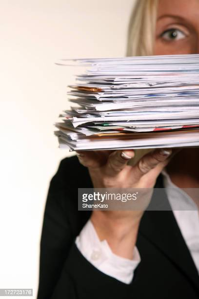 Business woman holding stack of Junk Mail and unpaid bills