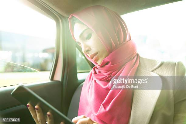 business woman in a taxi - turkey middle east stock photos and pictures