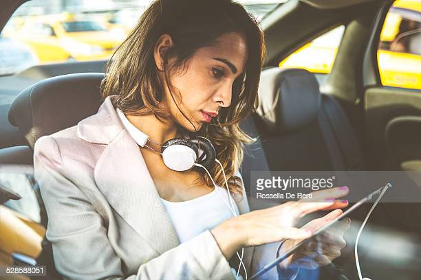 business woman in a taxi - 30 39 years stock pictures, royalty-free photos & images