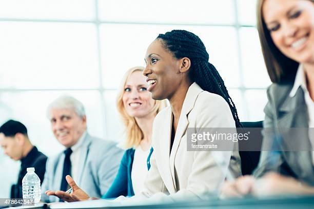 business woman in conference - q&a stock pictures, royalty-free photos & images