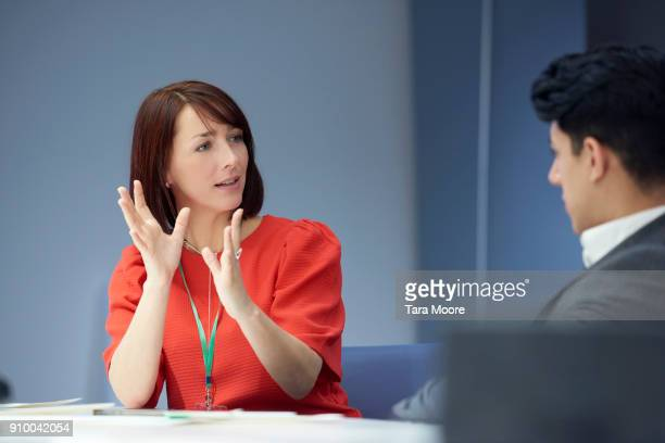 business woman in meeting - gesturing stock pictures, royalty-free photos & images