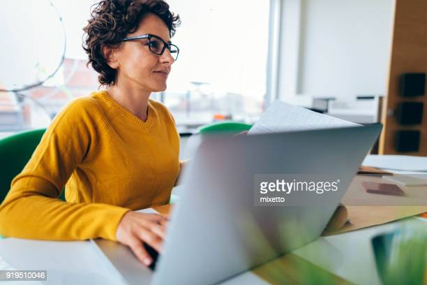 business woman in office - businesswear stock pictures, royalty-free photos & images