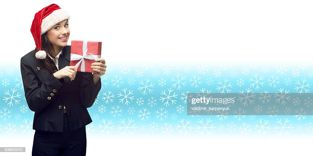 business woman in santa hat holding gift : Stock Photo