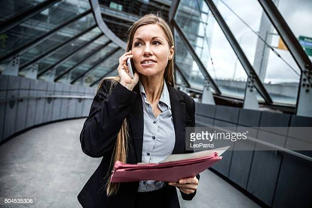Business woman in Sydney downtown having a call on mobile