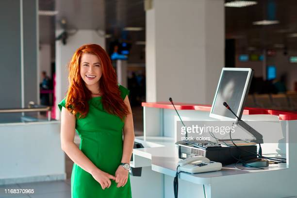 business woman in the airport - green dress stock pictures, royalty-free photos & images