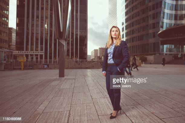 business woman in urban scene - hands in pockets stock pictures, royalty-free photos & images