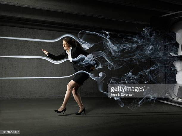 business woman in windtunnel - aerodynamic stock pictures, royalty-free photos & images